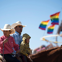100214      Cayla Nimmo<br /> <br /> Twister Jim waits on his horse with his father Jeff and brother Tracker before his turn in the goat roping competition Thursday afternoon at the Northern Navajo Nation Fair in Shiprock.