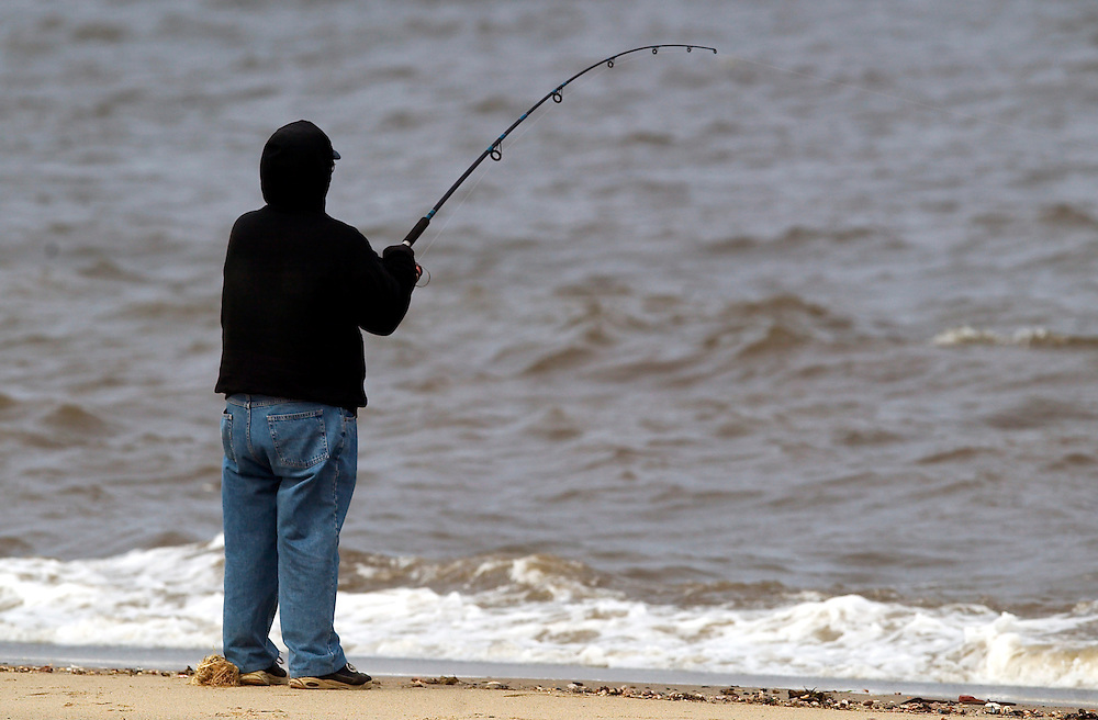 (PPAGE1) Union Beach 4/1/2004  Bob Deuchler of Union Beach fights a Striped Bass while fishing in Union Beach. .   Michael J. Treola Staff Photographer....MJT