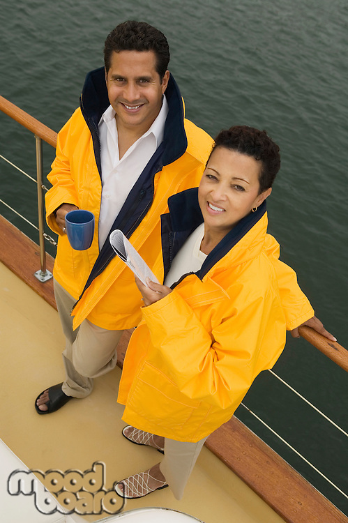 Couple Leaning Against Boat Railing