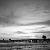 Orange County pier San Clemente California sunset black and white photo. San Clemente is a coastal city along the Pacific Ocean in the Western USA. Photo is high resolution. Copyright ⓒ 2017 Paul Velgos with All Rights Reserved.