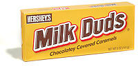 milk duds photographed on a white background