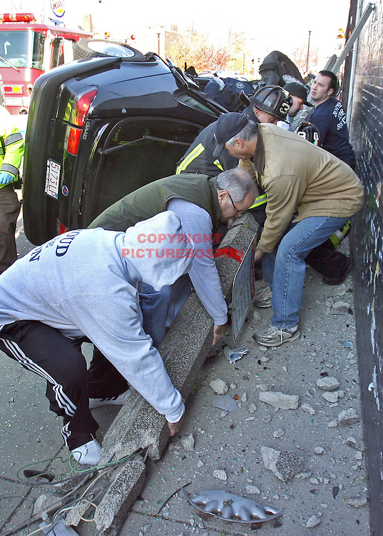 (11/10/07-Boston,MA) Boston Police cruiser and private auto involved in crash at the intersection of D street and West Broadway in South Boston. ED NOTE: Here, firefighters and civilians remove a pole from the scene to help in the extrication of the victim.Staff photo by Mark Garfinkel