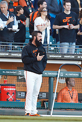 July 8, 2011; San Francisco, CA, USA;  San Francisco Giants relief pitcher Brian Wilson (38) stands outside the dugout during the national anthem before the game against the New York Mets at AT&T Park. New York defeated San Francisco 5-2.