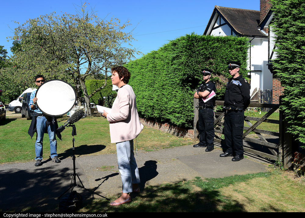 © Licensed to London News Pictures. 07/09/2012. Claygate, UK. A Television reporter performs a piece to camera in front of the house. The family home of Saad al-Hilli in Claygate, near Esher. Three members ofof the family have been shot dead in the French Alps. Photo credit : Stephen Simpson/LNP