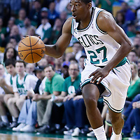28 April 2013: Boston Celtics shooting guard Jordan Crawford (27) brings the ball upcourt during Boston Celtics overtime 97-90 victory over the New York Knicks during Game Four of the Eastern Conference Quarterfinals of the 2013 NBA Playoffs at the TD Garden, Boston, Massachusetts, USA.