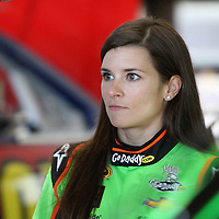NASCAR Sprint Cup driver Danica Patrick talks with a member of her race team during a NASCAR Daytona 500 practice session at Daytona International Speedway on Wednesday, February 20, 2013 in Daytona Beach, Florida.  (AP Photo/Alex Menendez)