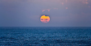 Orange sun setting over the Pacific Ocean panorama