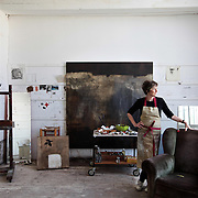 Artist Naomi Frears who has Studio 3. The building has been occupied by artists and fishermen for over 100 years, remaining virtually untouched.