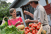 Woman talking with the farmer at a Roadside Fruit and vegetable market, Clarencetown, NSW, Australia