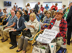 © Licensed to London News Pictures.  04/07/2017; Weston-super-Mare, North Somerset, UK. Members of the public wait for the start of a public board meeting at Weston General Hospital. A protest was held against the overnight closure of Weston General Hospital Accident and Emergency department is held before the Weston Area Health NHS Trust  Board meeting at Weston General Hospital which is to agree the temporary overnight closure of the Accident & Emergency department because of staffing levels, with no projected date given for a return to 24hr service. It was announced last month the A&E unit would be closing between 10pm and 8am from Tuesday 04 July, after a Care Quality Commission inspection raised concerns over the long-term sustainability of staffing levels. The decision has been made on patient safety grounds because the trust cannot provide enough specialist hospital doctors to safely staff the A&E department overnight. Patients arriving by ambulance will instead be taken to either the BRI or Southmead in Bristol, or Taunton's Musgrove Park hospitals, and anyone who would otherwise turn up to the A&E department themselves is being urged to either try to get to Bristol or ring the NHS helpline on 111. Unison, the trade union representing health workers, said it was vital the NHS bosses running Weston's hospital had a plan in place to reinstate the 24 hour service as soon as possible, so the temporary closure didn't become permanent. Unison says the closure comes from a staffing shortage that is the direct result of the government running down the NHS, and that on the week of the NHS' 69th birthday, they value this national treasure and the staff who keep it going more than ever. A hospital spokesman said they had no choice to close the unit after the CQC report rated the A&E department 'inadequate', and that A&E has been fragile for several years as a result of ongoing challenges around medical recruitment and a national shortage of A&E doctors which