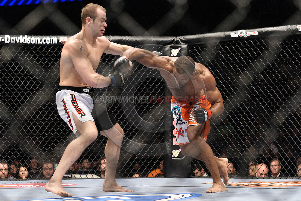 "LONDON, ENGLAND, JUNE 7, 2008: Kevin Burns (left) is clipped by an overhand right punch from Roan Carneiro during ""UFC 85: Bedlam"" inside the O2 Arena in Greenwich, London on June 7, 2008."