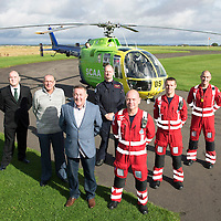 National Air Ambulance Week.. Britain's last Bolkow helicopter air ambulance operated by SCAA prepares to fly into history when it is replaced by EC-135 in November 2015. To mark this Scotland's original Bolkow paramedics gathered at Perth Airport to meet the current crew.<br /> Pictured from left to right Gerry Kelly, Robert Devine, Ian Golding who served as Paramedics on the Bolkow when first introduced to Scotland in 1989, Captain Russell Myles Senior Pilot, Paramedics John Salmond, Mark Tynan and Lead Paramedic John Pritchard<br /> Picture by Graeme Hart.<br /> Copyright Perthshire Picture Agency<br /> Tel: 01738 623350  Mobile: 07990 594431