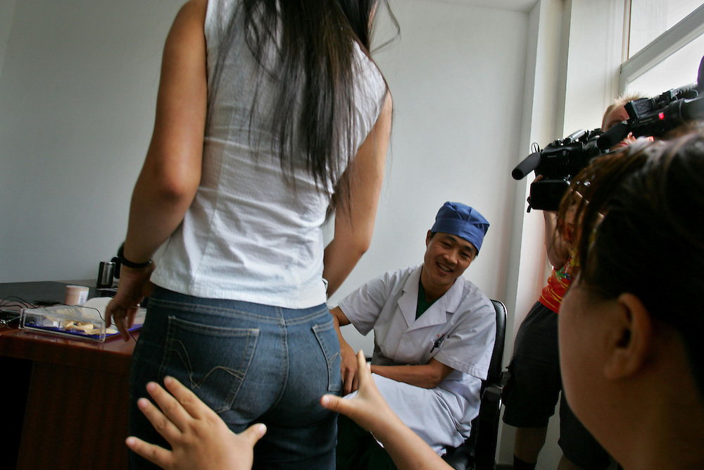 Hao Lulu, famous in China for her drive to transform herself through plastic surgery shows off her buttocks implants to her doctors before undergoing her 22nd operation in Beijing, China Aug. 24, 2005. An Estimated one million Chinese people per year flocking to plastic surgery as a way to boost their confidence as expendable incomes grow. Fueling the trend is a desire to compete in a rapidly changing society where image and first impressions count and social stigmas on buying perfection are few. A few decades ago, a Chinese woman could have been denounced and maybe even beaten for wearing lipstick, much less undergoing surgery to improve their looks. In the 1960s and 1970s, the closest thing to a Chinese beauty ideal was Liu Hulan, a robust 15-year-old country girl with a practical bob and not a trace of makeup who was decapitated by the Nationalists when she refused to name her fellow Communists in 1947.