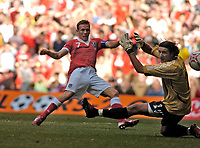 Photo: Leigh Quinnell.<br /> Wales v Slovakia. UEFA European Championships 2008 Qualifying. 07/10/2006. Craig Bellamy gets the ball past the Slovakian keeper Kamil Contofalsky, but it is not given.