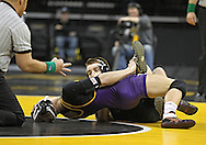 December 8, 2011: Iowa Hawkeyes Josh Dziewa scores near fall points as he controls Northern Iowa Panthers Clay Welter in the 149 pound bout of the NCAA wrestling dual between the Northern Iowa Panthers and the Iowa Hawkeyes at Carver-Hawkeye Arena in Iowa CIty, Iowa on Thursday, December 8, 2011. Dziewa defeated Welter 14-6 and Iowa defeated Northern Iowa 38-4.