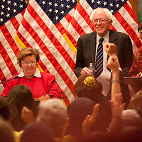 Guests cheer as Sen. Barbara Mikulski, Sen. Bernie Sanders and Sen. Zoe Lofgren lead a special hearing promoting job creation Nov. 17, 2011.
