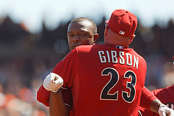 September 4, 2011; San Francisco, CA, USA;  Arizona Diamondbacks manager Kirk Gibson (23) restrains right fielder Justin Upton (back) after Upton was ejected from the game by MLB umpire Brian Knight (not pictured) during the fourth inning at AT&T Park. Arizona defeated San Francisco 4-1.