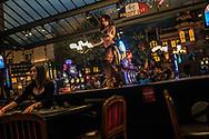 Dancer on the bar at Paris Las Vegas Casino.  Las Vegas, Nevada.