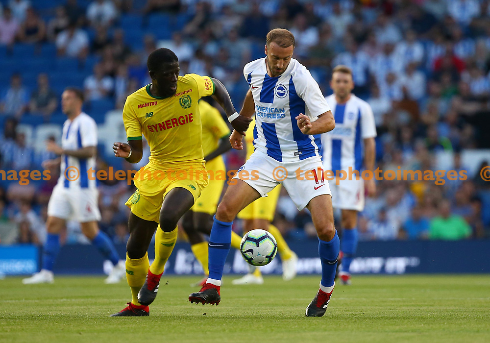 Abdoulaye Toure of FC Nantes challenges Glenn Murray of Brighton during the pre season friendly between Brighton and Hove Albion and FC Nantes at the American Express Community Stadium in Brighton. 03 Aug 2018