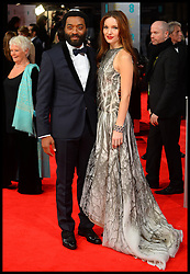 Chiwetel Ejiofor and Sari Mercer arrives for the EE BRITISH ACADEMY FILM AWARDS 2014 (BAFTA) at the The Royal Opera House in Covent Garden . London, United Kingdom. Sunday, 16th February 2014. Picture by Andrew Parsons / i-Images