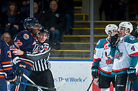 KELOWNA, CANADA - FEBRUARY 24: Linesman Tim Plamondon gets between Jermaine Loewen #32 of the Kamloops Blazers and Gordie Ballhorn #4 of the Kelowna Rockets during second period  on February 24, 2018 at Prospera Place in Kelowna, British Columbia, Canada.  (Photo by Marissa Baecker/Shoot the Breeze)  *** Local Caption ***