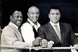 London, England, UK; Former Heavyweight World Champion boxer MUHAMMAD ALI (Cassius Marcellus Clay, Jr. on Jan 17, 1942) turned 65 today. PICTURED: (L-R) Heavyweight heros JOE FRAZIER, GEORGE FOREMAN and MUHAMMAD ALI on parade at the docklands Arena in London to promote a new boxing video.