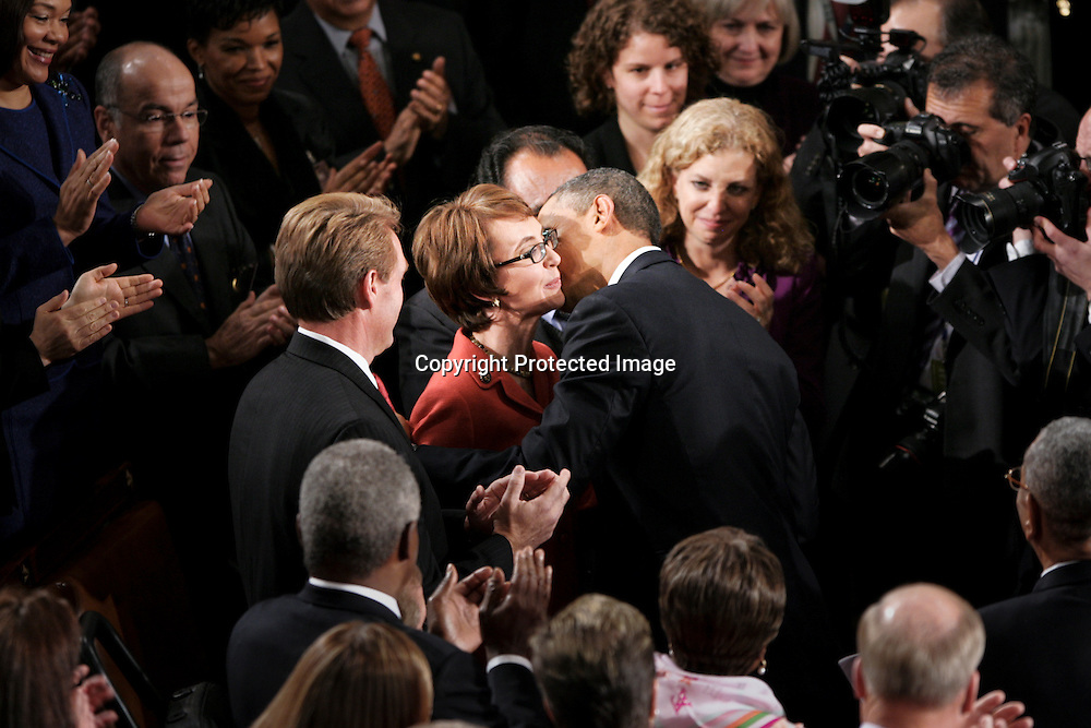 U.S. President Barack Obama greets Rep. Gabrielle Giffords (D-AZ) with a kiss as he arrives for the State of the Union address at the U.S. Capitol in Washington, January 24, 2012.