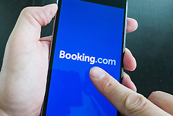 Booking.com hotel room booking app on an iPhone 6 Plus smart phone