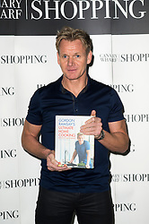 © Licensed to London News Pictures. 13/12/2013. Canary Wharf, London. Celebrity chef, Gordon Ramsey signs copies of his new book, Ultimate Home Cooking. Photo credit : Simon Ford/LNP