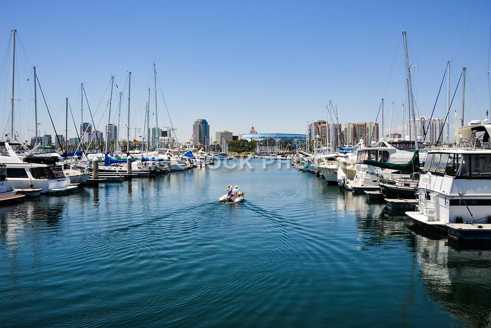 Couple in Small Raft Cruising Through Shoreline Marina in Long Beach