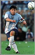 Argentine football legend Diego Maradona kicks the ball during an event in his honor at La Bomobonera stadium in Buenos Aires, Argentina, on November 10, 2001. (Alejandro PAGNI/PHOTOXPHOTO)