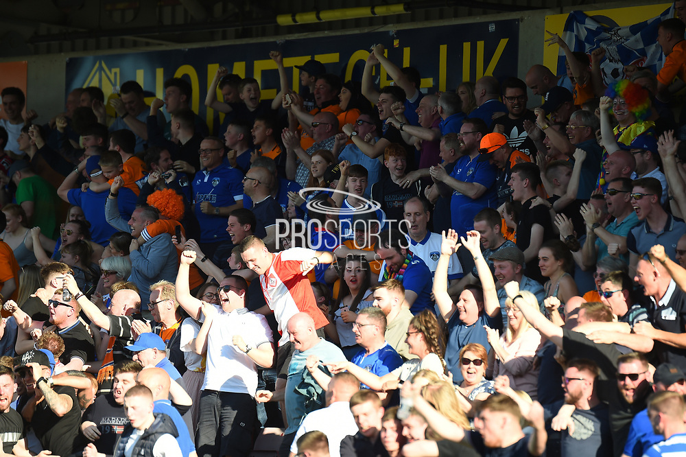 The Oldham fans celebrate during the EFL Sky Bet League 1 match between Northampton Town and Oldham Athletic at Sixfields Stadium, Northampton, England on 5 May 2018. Picture by Dennis Goodwin.