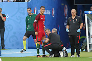 Portugal Forward Cristiano Ronaldo getting medical attention during the Euro 2016 final between Portugal and France at Stade de France, Saint-Denis, Paris, France on 10 July 2016. Photo by Phil Duncan.