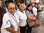 12 DECEMBER 2013 - BANGKOK, THAILAND:  People line Phra Sumen Road in front of Wat Bowon Niwet in Bangkok during a mourning service for the Supreme Patriarch of Thailand. Somdet Phra Nyanasamvara, who headed Thailand's order of Buddhist monks for more than two decades and was known as the Supreme Patriarch, died Oct. 24 at a hospital in Bangkok. He was 100. He was ordained as a Buddhist monk in 1933 and rose through the monastic ranks to become the Supreme Patriarch in 1989. He was the spiritual advisor to Bhumibol Adulyadej, the King of Thailand when the King served as monk in 1956. There is a 100 day mourning period for the Patriarch, the service Thursday, on the 50th day, included members of the Thai Royal Family. Although the Patriarch was a Theravada Buddhist, he was the Supreme Patriarch of all Buddhists in Thailand, including the Mahayana sect, which is based in Chinese Buddhism.    PHOTO BY JACK KURTZ