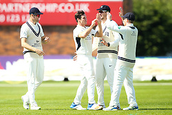 Hilton Cartwright of Middlesex celebrates with teammates after taking the wicket of Alex Hughes of Derbyshire- Mandatory by-line: Robbie Stephenson/JMP - 20/04/2018 - CRICKET - The 3aaa County Ground  - Derby, England - Derbyshire CCC v Middlesex CCC - Specsavers County Championship Division Two
