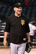 PHOENIX, AZ - APRIL 06:  Bruce Bochy #15 of the San Francisco Giants laughs while playing catch on the field prior to the game against the Arizona Diamondbacks at Chase Field on April 6, 2017 in Phoenix, Arizona.  The Arizona Diamondbacks won 9-3.  (Photo by Jennifer Stewart/Getty Images)