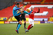 Fleetwood Town defender Conor McLaughlin (2) clears the ball under pressure from Charlton Athletic midfielder Ricky Holmes (11) during the EFL Sky Bet League 1 match between Charlton Athletic and Fleetwood Town at The Valley, London, England on 4 February 2017. Photo by Andy Walter.