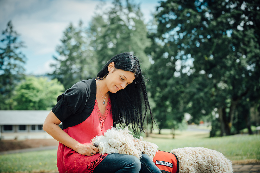 Nala therapy dog with her handler at the Betty Ford Hazelden Center in Newberg, Oregon