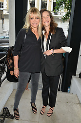 Left to right, JO WOOD and LEAH WOOD at a private view and launch of the new Heist Gallery at 43 Linden Gardens, London W2 on 12th June 2014.