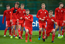 NEWPORT, WALES - Monday, October 14, 2019: Wales' Joe Adams (L) and Ryan Astley during the pre-match warm-up before an Under-19's International Friendly match between Wales and Austria at Dragon Park. (Pic by David Rawcliffe/Propaganda)