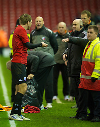 LIVERPOOL, ENGLAND - Wednesday, December 15, 2010: Liverpool's stadium manager Ged Poynton tries to tell the FC Utrecht players they cannot salute their supporters on the pitch during the UEFA Europa League Group K match at Anfield. (Photo by: David Rawcliffe/Propaganda)