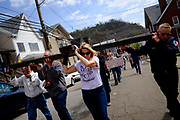 "Lori Mizgorski of Shaler, Pa. joined the Christian faithful as they act out ""The Drama of the Cross"" in the streets of Etna, Pa. on April 14, 2017, in Etna, Pa."