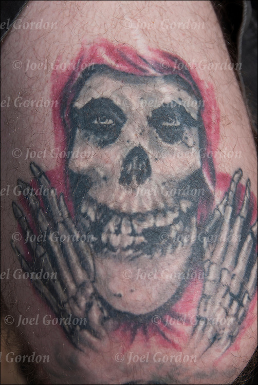 Close up tattoo on his shoulder.<br /> <br /> Body art or tattoos has entered the mainstream it is known longer considered a weird kind of subculture.<br /> <br /> &quot;According to a 2006 Pew survey, 40% of Americans between the ages of 26 and 40 have been tattooed&quot;.