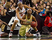 Georgia Tech's Mo Bennett comes up with this loose ball as Maryland's Diandra Tchatchouang defends during Georgia Tech's 70 - 64 victory over Maryland in the 2011 ACC Women's Basketball Tournament held at the Greensboro Coliseum in Greensboro, North Carolina.  (Photo by Mark W. Sutton)
