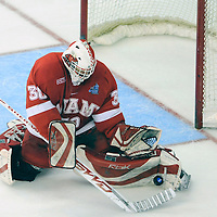 11 April 2009:   Miami University goalie Cody Reichard (30) makes a pad save on shot by the Boston University Terriers in the 2nd period at the Verizon Center in Washington, DC in the Division I Mens Ice Hockey Championship.  The Boston University Terriers defeated the Miami University (Ohio) Redhawks 4-3 in overtime to win the NCAA Mens Ice Hockey Championship.