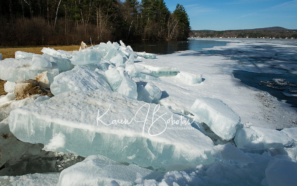 Leslie E. Roberts Beach in Belmont is in need of some  warm Spring cleanup as large ice chunks washed up on shore from strong winds on Lake Winnisquam this week.  (Karen Bobotas/for the Laconia Daily Sun)