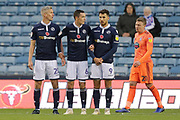 Millwall striker Steve Morison (20) Millwall midfielder Shaun Williams (6) and Millwall striker Lee Gregory (9) form a wall besides Ipswich Town Striker Freddie Sears (20) during the EFL Sky Bet Championship match between Millwall and Ipswich Town at The Den, London, England on 27 October 2018.