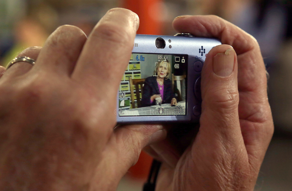(Hampton, NH - 5/22/15) A man takes a snapshot of former Secretary of State and presidential candidate Hillary Clinton as she meets with small business owners at  Smuttynose Brewery, Friday, May 22, 2015. Staff photo by Angela Rowlings.