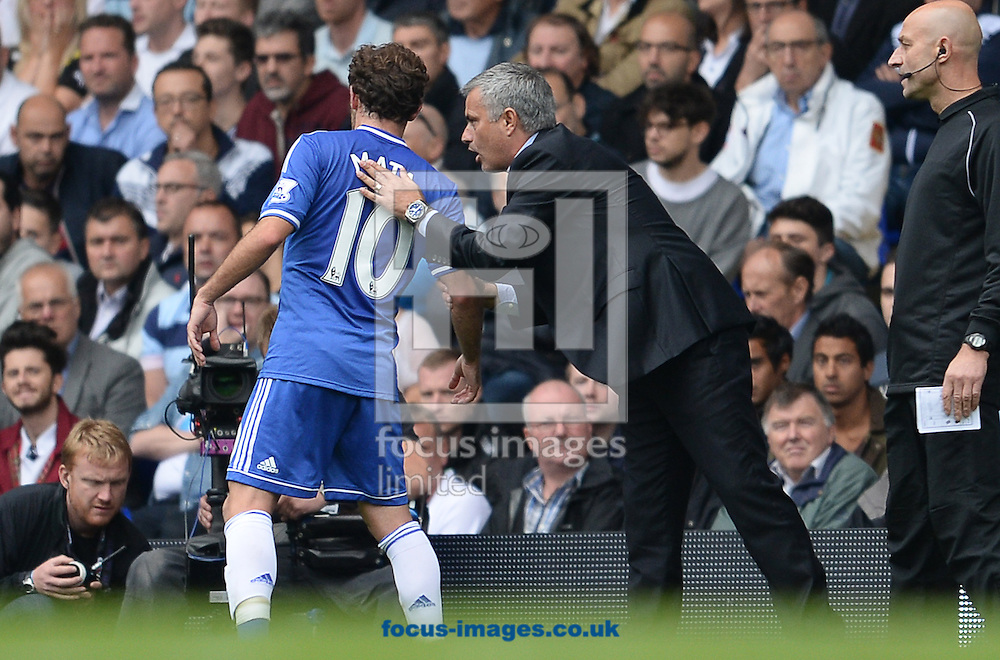 Picture by Andrew Timms/Focus Images Ltd +44 7917 236526<br /> 28/09/2013<br /> Manager of Chelsea Jose Mourinho &amp; Juan Mata during the Barclays Premier League match against Tottenham Hotspur at White Hart Lane, London.