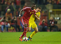 BRUSSELS, BELGIUM - Sunday, November 16, 2014: Wales' James Chester and Belgium's Christian Benteke during the UEFA Euro 2016 Qualifying Group B game at the King Baudouin [Heysel] Stadium. (Pic by David Rawcliffe/Propaganda)